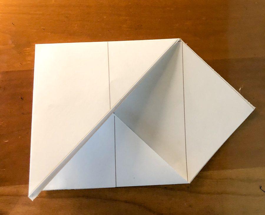 Fold into a square.